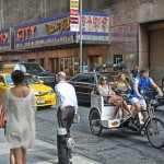 Radio City and people with a pedicab