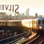 Long Island City, No. 7 train rounding the bend with the Silvercup sign and the NYC skyline in the background.