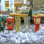 Newspaper boxes in the Snow. West Broadway in SoHo